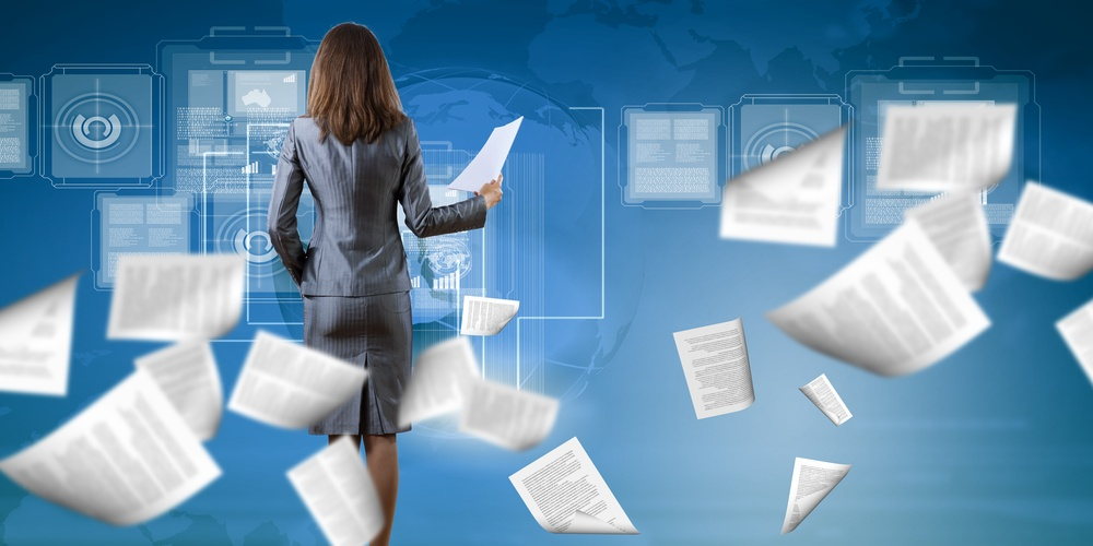Back view of businesswoman holding papers in hands.jpeg